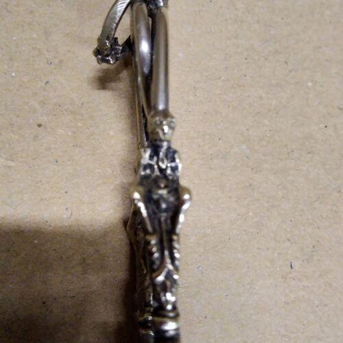 Pince à sucre avec chimère en métal argenté