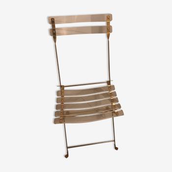 Chaise pliante en plexiglass et laiton