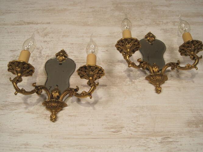 Paire d'appliques à fond de miroir double feux en bronze style Régence début XX