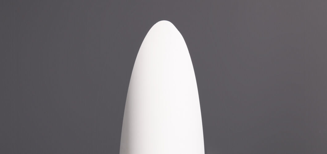 Unghia mirror designed by Rodolfo Bonetto in white