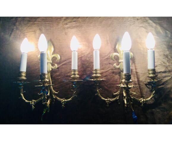 Paire d'appliques fleurs de lys bronze 3 lumières