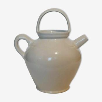 Old jug chevrette gargoulette in varnished white sandstone