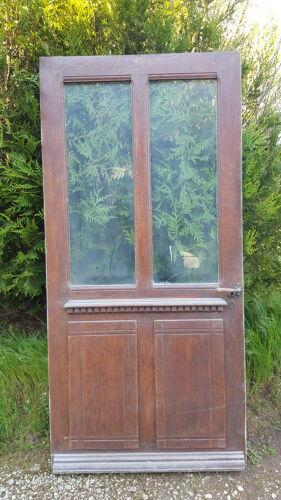 Porte d'entrée ancienne vitrée en chêne chevillée
