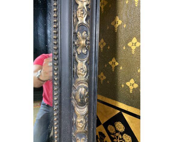 Miroir époque Napoléon III en bois noirci et doré 90x147cm