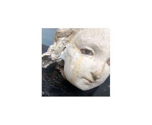 Tête d'enfant ancienne en plâtre