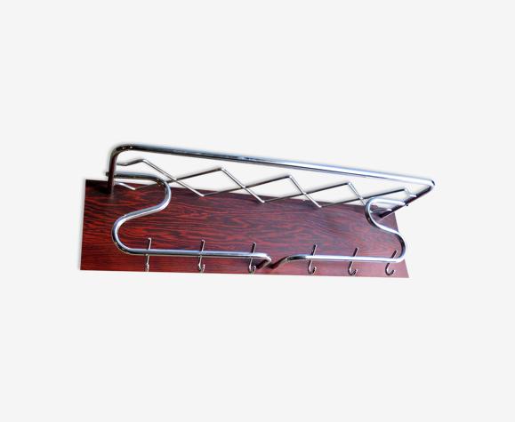 Chrome metal in a rosewood veneer board coat rack