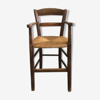 Old wooden child high chair with mulched seat