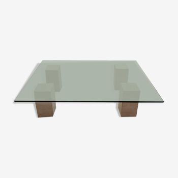 Table en verre et pieds en travertin