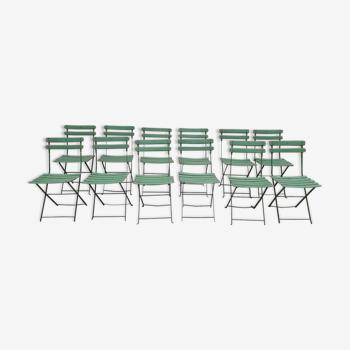 Serie de 12 chaises de bistrot en fer Manufrance